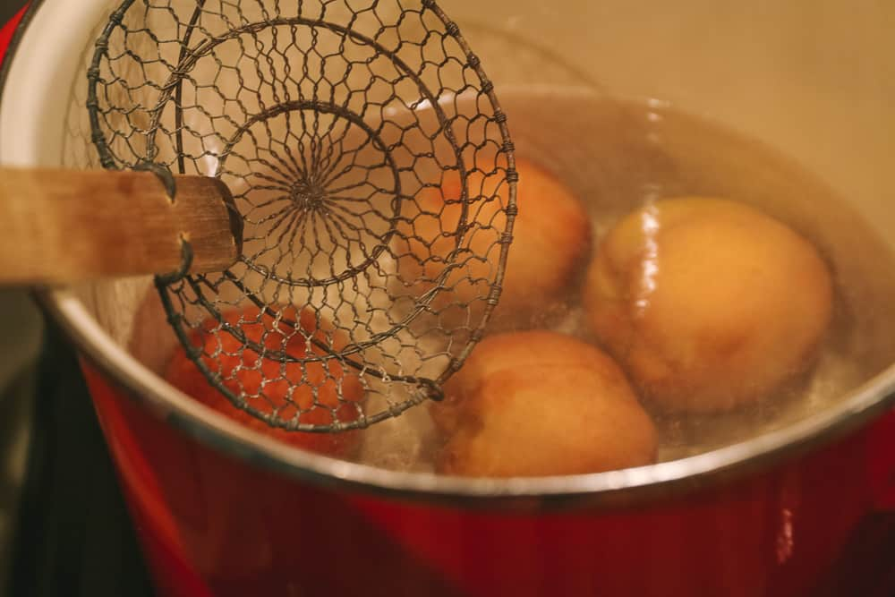 peeling peaches in boiling water