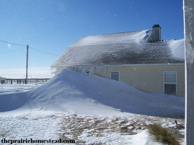 Our first winter. The front door is behind the snow drift. Fun, eh?