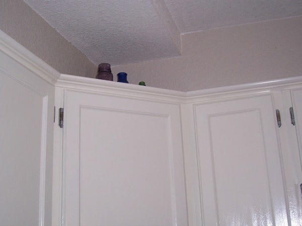 adding crown molding to cabinets
