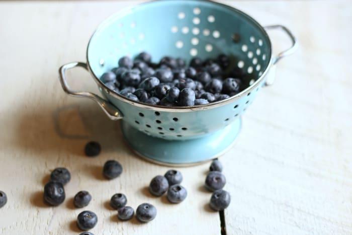 fresh blueberries in colander