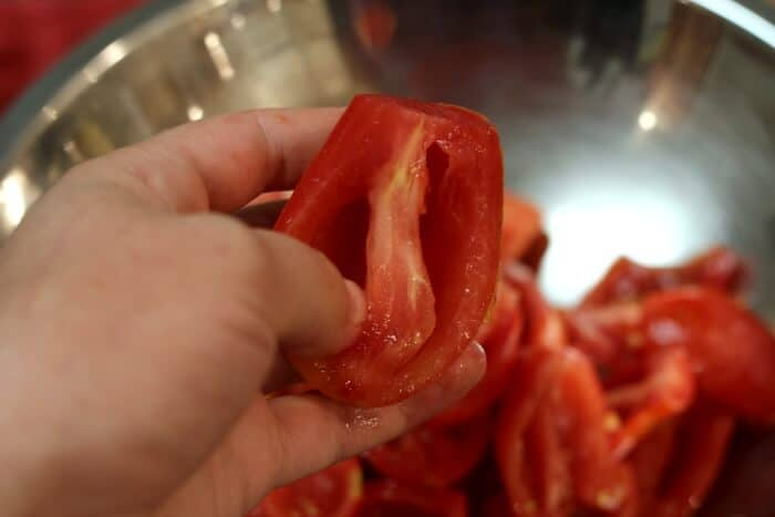 How to Freeze Tomatoes: taking out the seeds