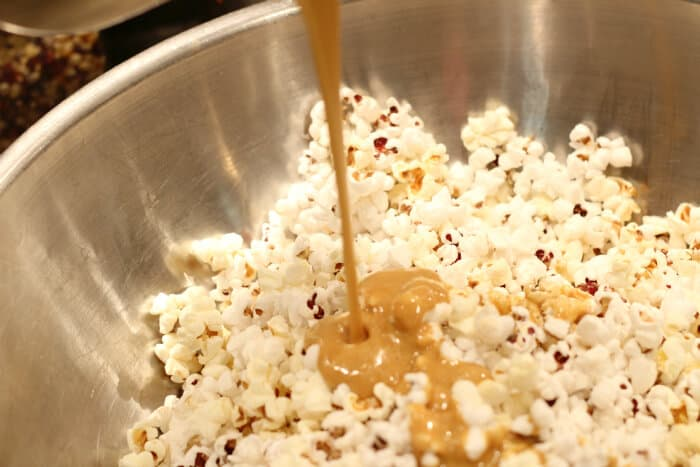 Drizzling caramel on the popcorn