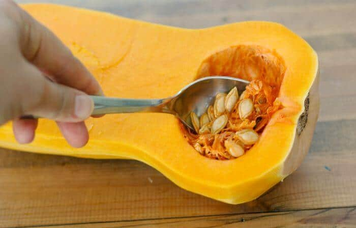 scooping seeds out of squash