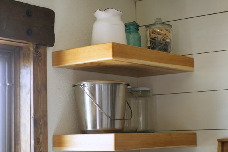 open shelving in laundry room