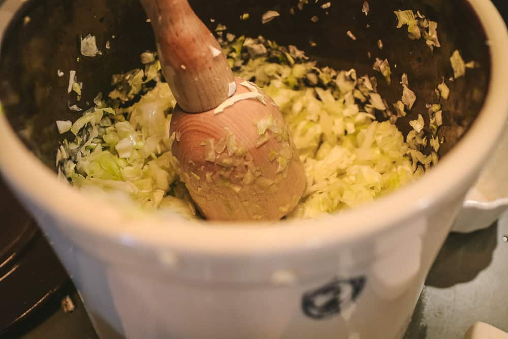 making sauerkraut in ferment crock